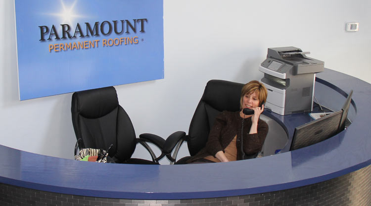 Receptionist at Paramount Roofing answering the phone